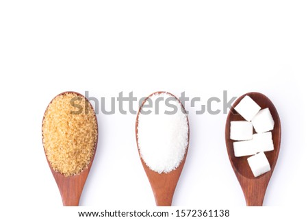 Closeup brown and white sugar in wooden spoon isolated on white background. Unhealthy eating ,awareness and stop diabetes concept. Top view. Flat lay.