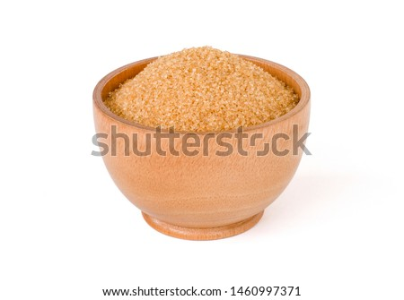 Closeup brown granulated sugar in wooden bowl isolated on white background with clipping path. Unhealthy diet ,awareness and stop diabetes concept.