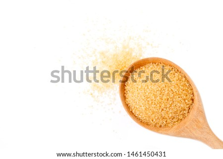 Closeup brown granulated sugar in wooden spoon isolated on white background. Unhealthy diet ,awareness and stop diabetes concept. Top view. Flat lay.