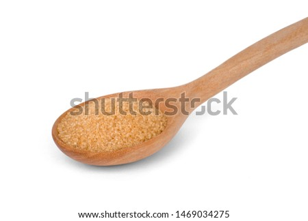 Closeup brown sugar in wooden spoon isolated on white background with clipping path. Unhealthy diet ,awareness and stop diabetes concept.