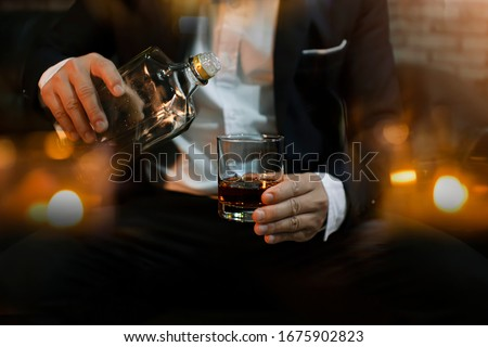 Closeup businessmen holding a glass of whiskey ストックフォト ©