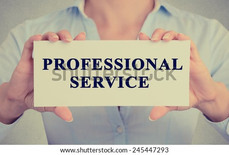 Closeup businesswoman hands holding Professional service sign card towards you, vintage retro filter effect toned image