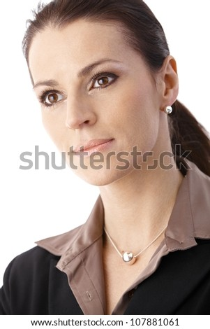 Closeup businesswoman portrait, looking confident and determined.
