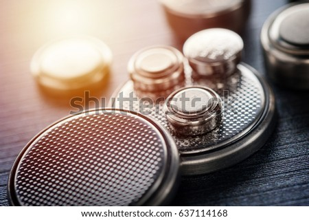 closeup button cell battery or watch battery or coin cell, used to power small electronics devices such as wrist watches or computer motherboard. #637114168