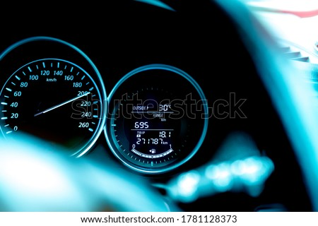 Closeup car fuel gauge dashboard panel. Gasoline indicator meter and speedometer. Fuel gauge show full gas tank. Data information dashboard show outside car temperature, trip range and fuel tank icon.