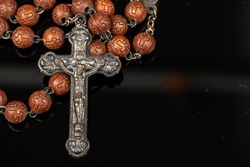 Closeup Catholic rosary beadsreligious neckless symbol
