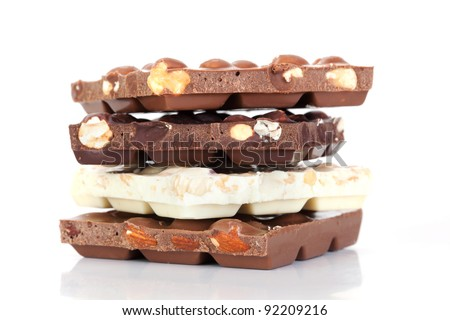 Closeup chocolate bar with nuts on white background