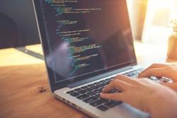 Closeup coding on screen, Woman hands coding html and programming on screen laptop, development web, developer.