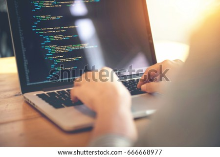 Closeup coding on screen, Woman hands coding html and programming on screen laptop, development web, developer.