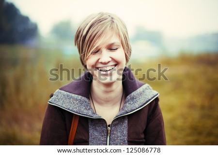 Closeup colorful portrait of young happy laughing girl