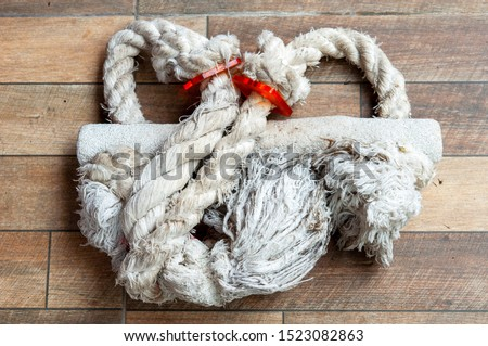 Closeup cotton rope perch for macaws and other large parrots, dirty and be tender