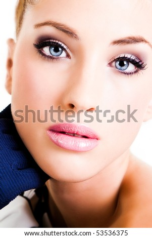 Closeup, cropped portrait of a young woman. Her hand is near her face and she is wearing gloves. Vertical shot. Isolated on white.