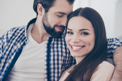Closeup cropped portrait of cheerful positive couple bearded man enjoying smell parfume of his smiling charming lover. True feelings affection idyllic harmony concept