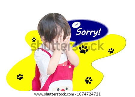 Closeup cute asian kid put his hand in front of him with I'm sorry word in text box isolated on white background