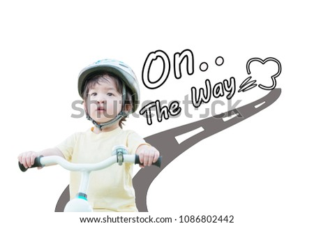 Closeup cute asian kid ride a bike with on the way word isolated on white background