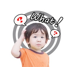 Closeup cute asian kid with confuse motion and question mark icon with what word isolated on white background