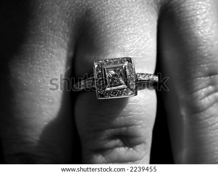Closeup detail of a custom made princess cut diamond engagement ring.