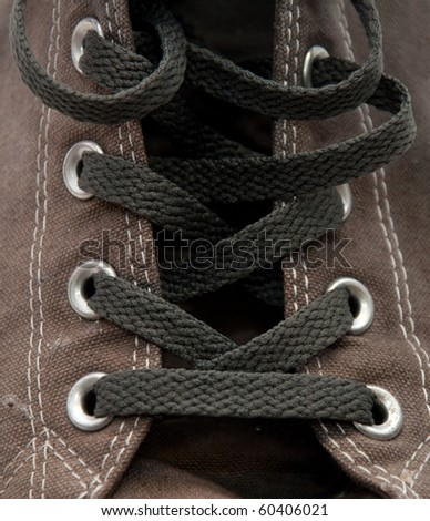 closeup detail of a pair of old, dirty gray sneakers