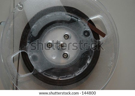 Closeup detail of an analog tape racked on a reel to reel tape machine