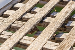 Closeup detail of an weathered damaged wooden gangway.