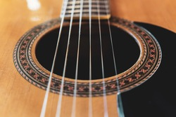 Closeup detail of classical guitar with nylon strings.
