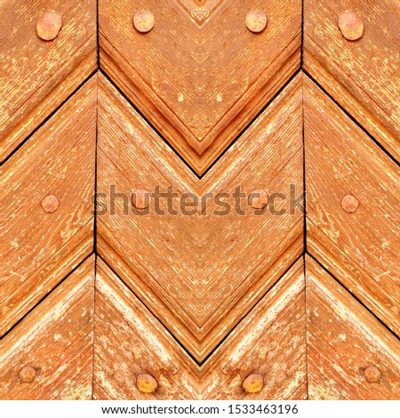 closeup detail of detail design and pattern on wooden door diagonal sections and grain