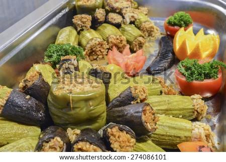 Closeup detail of dolma stuffed vegetables on display at an oriental restaurant buffet
