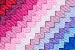 Closeup detail of multi color fabric texture samples