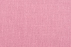 Closeup detail of pink fabric texture background