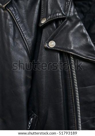 closeup detail of vintage black leather biker jacket