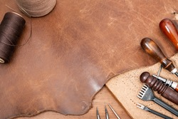 closeup details of brown leather, material for leather working.