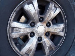 Closeup - dirty car wheels. Aluminum wheels have a lot of dust or black soot on the wheel rim caused by worn brake pads. Selective focus
