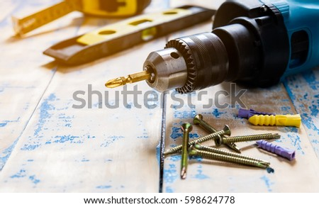closeup drill tool on wood background