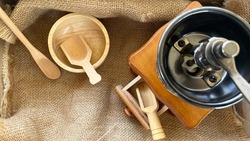 Closeup Empty Coffee Grinder Manual With Empty Wooden Dish With Coffee Bean on Table...