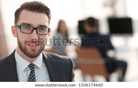 closeup.Executive businessman on background of office. #1106174660