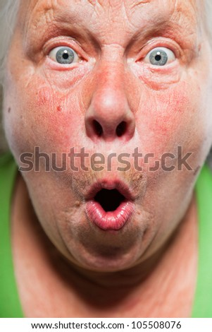 Closeup expressive face of senior woman. Studio shot.