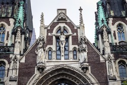 closeup facade with crucifix scene sculptures on catholic cathedral church of St. Olga and Elizabeth in Lviv, Ukraine