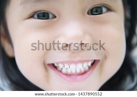 closeup face for asian child cute or kid girl smiling white teeth by toothpaste with eye and beauty skin on pink mouth in dental clinic and hospital with cheerful and happy at school, teeth focus stock photo