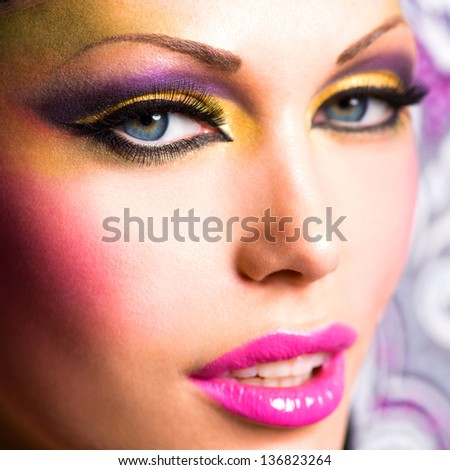 Closeup face of beautiful woman with fashion bright makeup