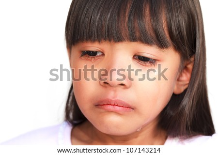 Closeup face of little girl crying with tears rolling down her cheeks