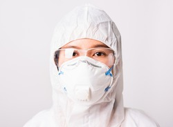 Closeup face of portrait woman doctor or scientist in PPE suite uniform wearing face mask N95 protective and eyeglasses in lab, coronavirus or COVID-19 concept isolated white background