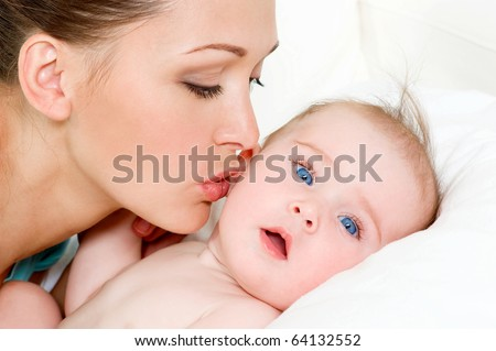 Closeup faces of young happy mother with cute newborn baby