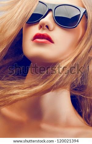 closeup fashion beautiful woman portrait with long hair wearing sunglasses