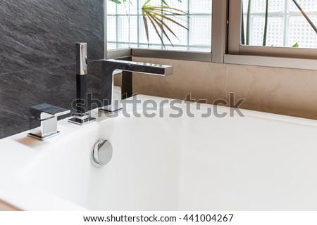 closeup faucet of bathtub in bathroom