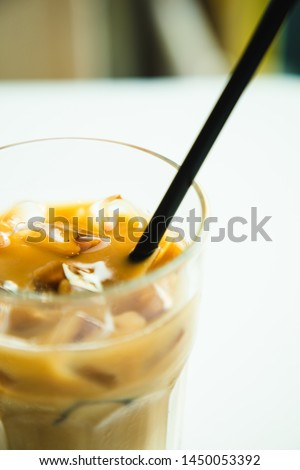 Closeup female female drinking coffee by window with mobile phone