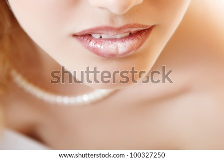 Closeup female lips. Isolated over white background - stock photo