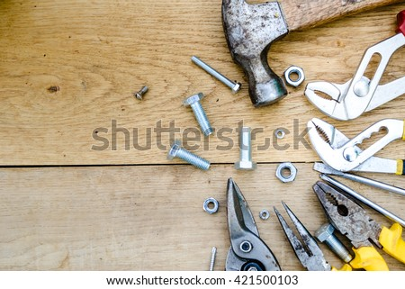 Closeup flat lay of tools on a wooden surface texture, top view #421500103