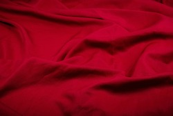 Closeup folds of wine-red drapery (with copyspace for text)