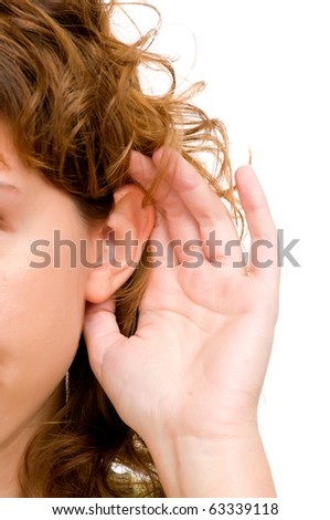 Closeup for female hand on ear. Listening. Vertical