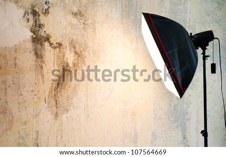 Closeup fragment of grunge weathered wall with lighting lamp